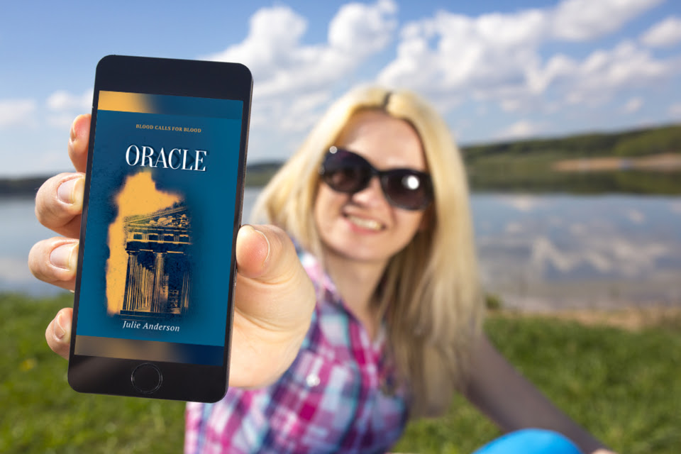 Oracleonphoneheldbywomanatlake